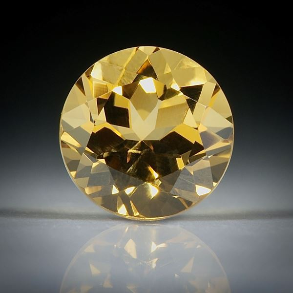 Goldberyll rund facettiert 1.59ct.  7.5x7.5x5mm