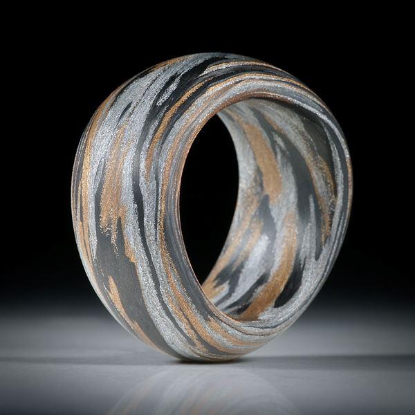 Karbonring Fibertec, mit Glasfaser Bronze und Alu, geschwungene Form mit bombierter Aussenseite
