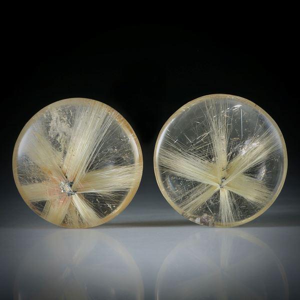 Sternrutil Paar, 18.4ct. runde Cabochon, beidseitig bombiert geschliffen und poliert, je ca.16x15x5mm
