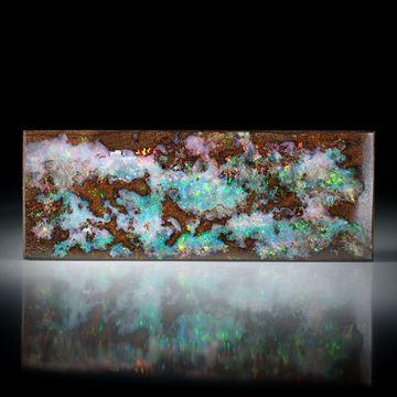 Boulderopal Australien 52.65ct. rechteckige Form ca.56x21x4mm