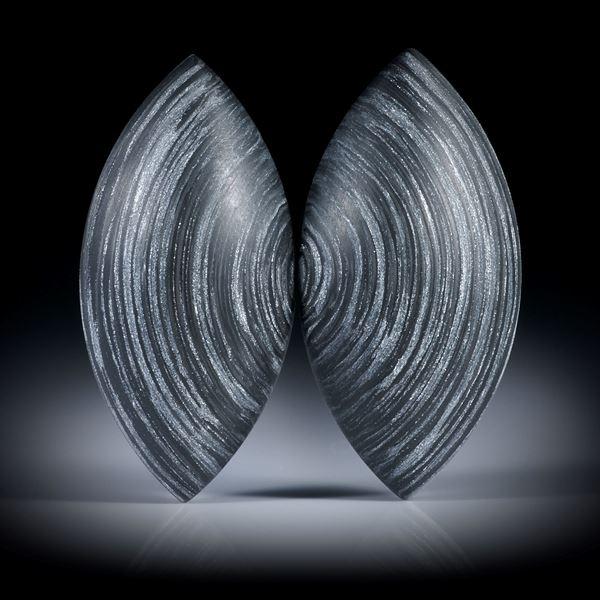 Carbonpaar mit Textilglas Alu, in Epoxymatrix, Navetteformen bombiert, je ca.34x17x6.5mm