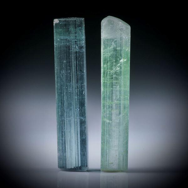 Turmalinkristall Paar, total 14.3ct. mit angeschliffenen Standflächen, je ca.26x5.5x5mm und ca.27x5x4.5mm