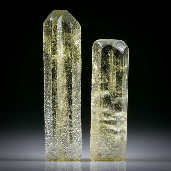 Goldberyll Kristall Paar 83.92ct. ca.50x13x11mm und 40.5x12x10mm