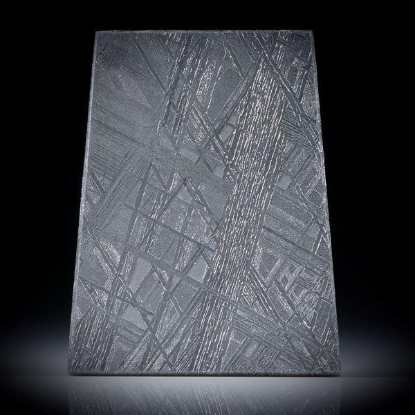 Eisenmeteorit mit geätzter Oberfläche, Trapezform ca.36x28.5x2.5mm